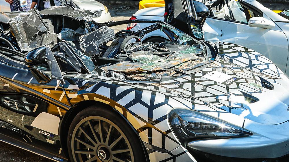A closeup of the destroyed McLaren 620R