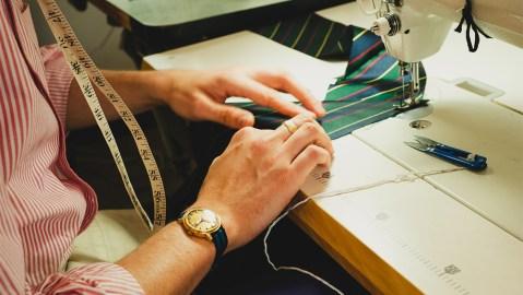Jake Wigham at work on one of his handmade silk ties.