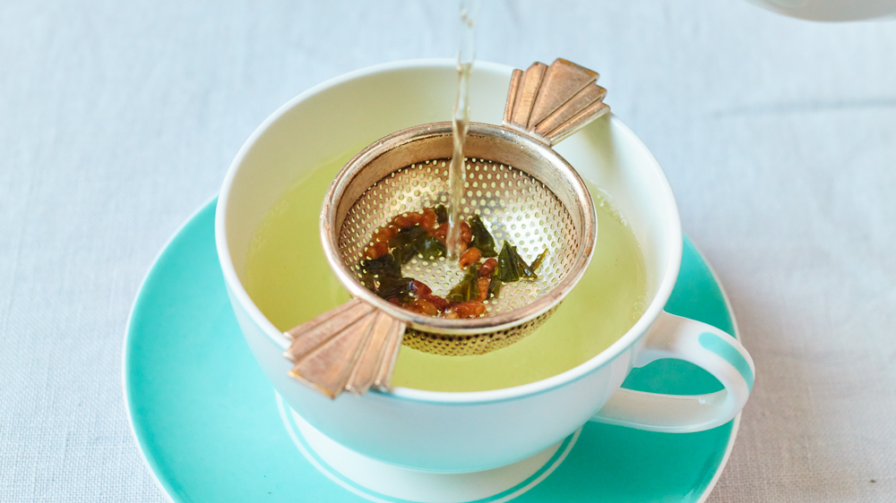 tea cup being prepared