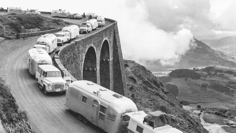 An airstream caravan negotiates a mountain pass.