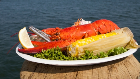 Whole steamed lobster with corn