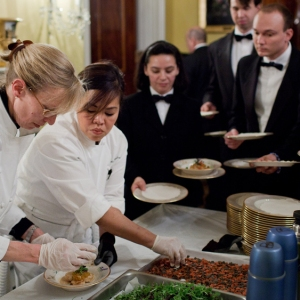 Cristeta Comerford plating dishes for governor's dinner white house chef