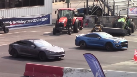 A Tesla Model S Plaid and Ford Mustang Shelby GT500 drag race
