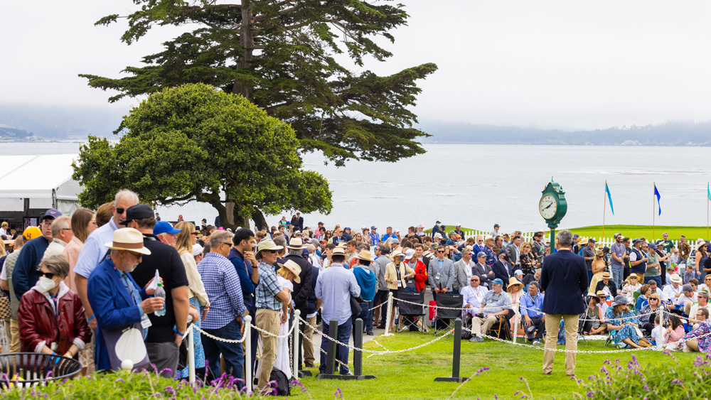 A crowd gathers to catch a glimpse of the awards ceremony at the 2021 Pebble Beach Concours d'Elegance.