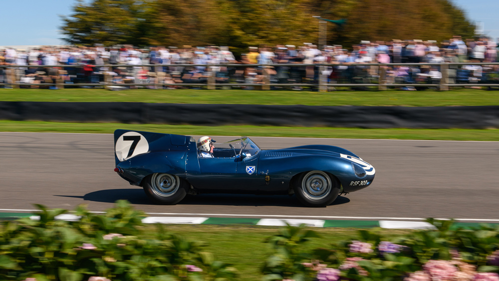Racer Jackie Stewart drives during the 1959 TT Celebration at the 2019 Goodwood Revival.