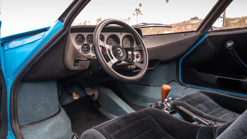 The interior of a 1975 Lancia Stratos HF Stradale rally car.