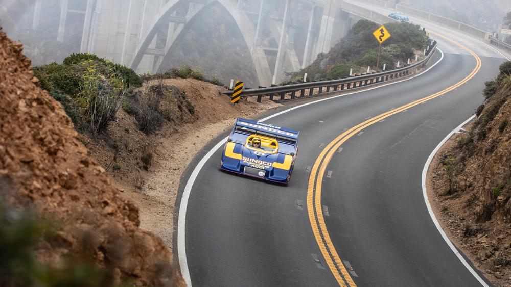 A 1973 Porsche 917/30 Can-Am Spyder cruises along the coast during the 2021 Pebble Beach Tour d'Elegance.