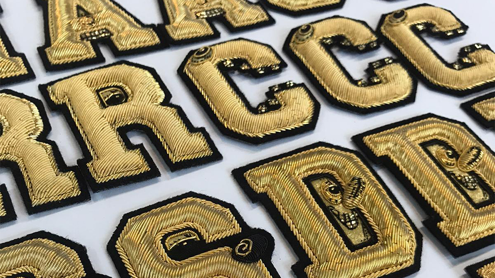 Bullion-embroidered patches made by Hand & Lock for Christian Dior.