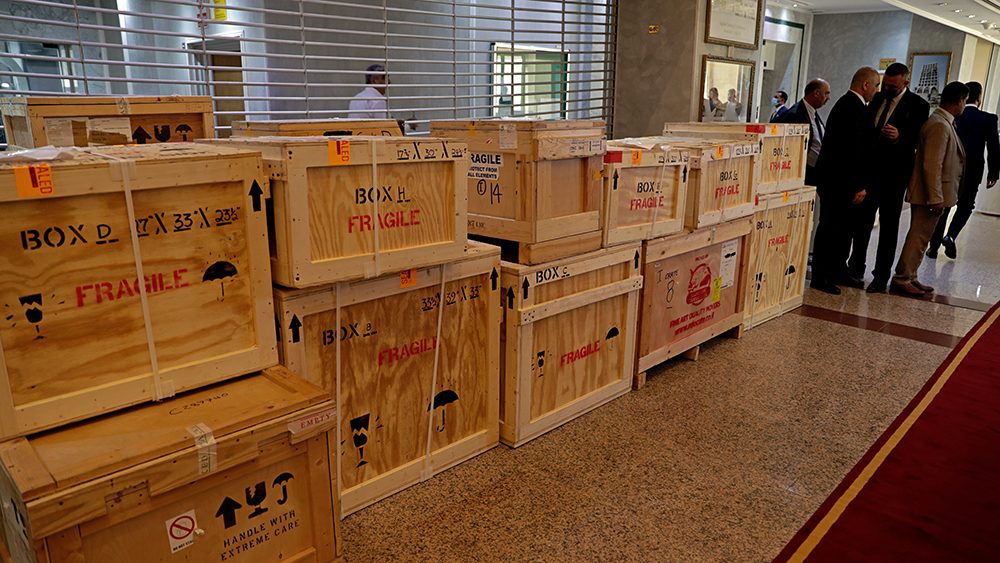 Boxes containing recovered looted artifacts sit temporarily at the foreign ministry before being transferred to the Iraq Museum, in Baghdad, Iraq, Tuesday, Aug. 3, 2021. Over 17,000 looted ancient artefacts recovered from the United States and other countries were handed over to Iraq's Culture Ministry on Tuesday, a restitution described by the government as the largest in the country's history. The majority of the artefacts date back 4,000 years to ancient Mesopotamia and were recovered from the U.S. in a recent trip by Prime Minister Mustafa al-Kadhim. (AP Photo/Khalid Mohammed)