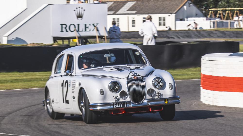 A Jaguar MK II races at the 2021 Goodwood Revival.