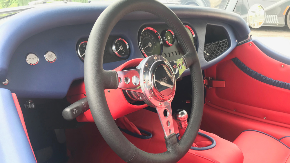 The steering wheel and dash of a 2019 Morgan Plus 4.