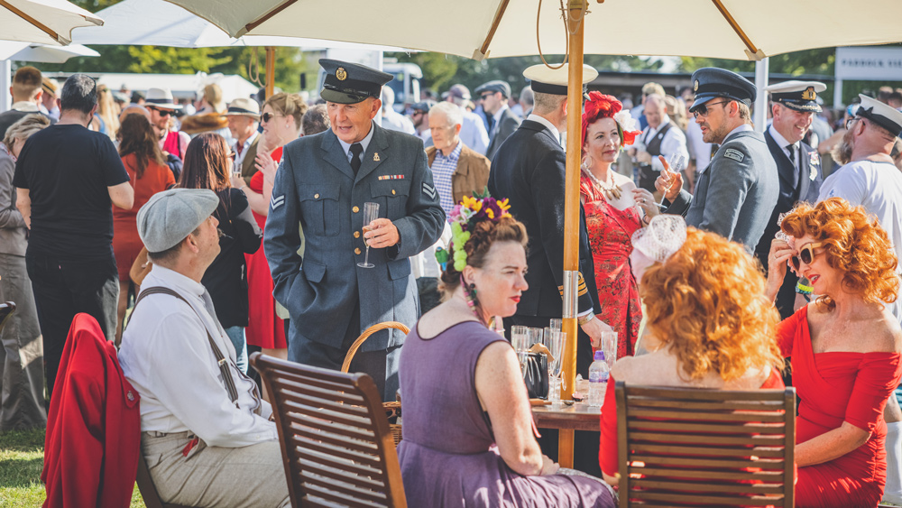Attendees of the 2021 Goodwood Revival in period-correct attire.