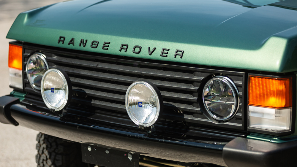 A closeup of the front of a 1991 Range Rover Classic restomod.