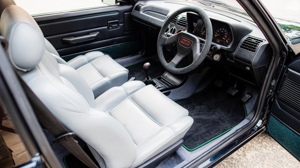 The interior of Tolman Motorsport's Peugeot 250 GTI restomod.