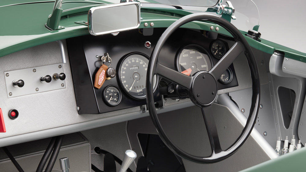 The dashboard and steering wheel inside a Jaguar C-type Continuation.
