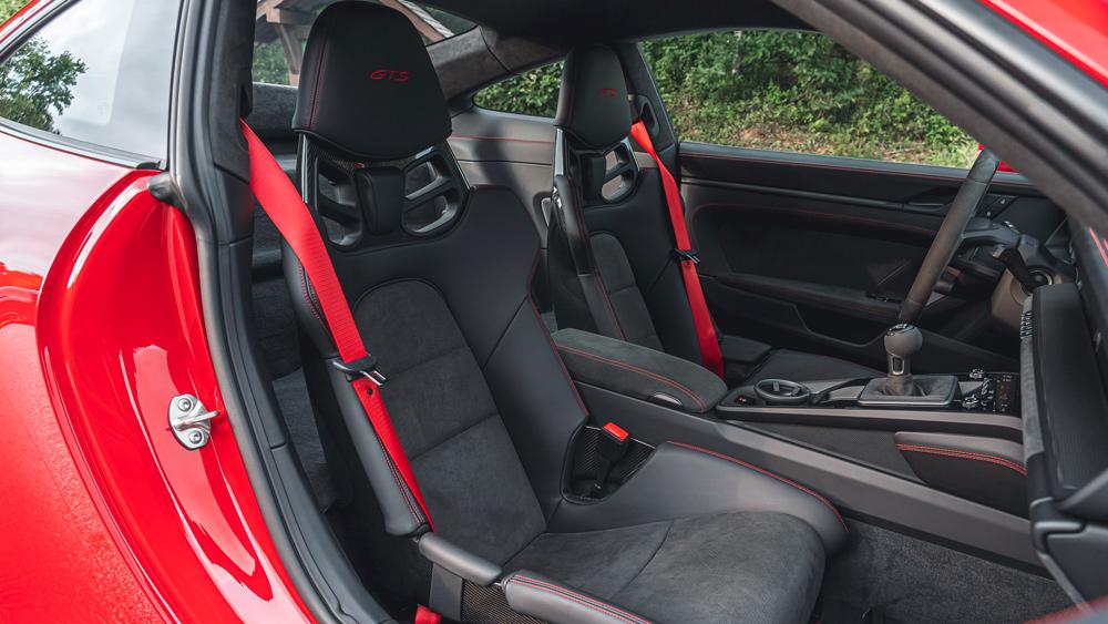 The cockpit of a 2022 Porsche 911 GTS.