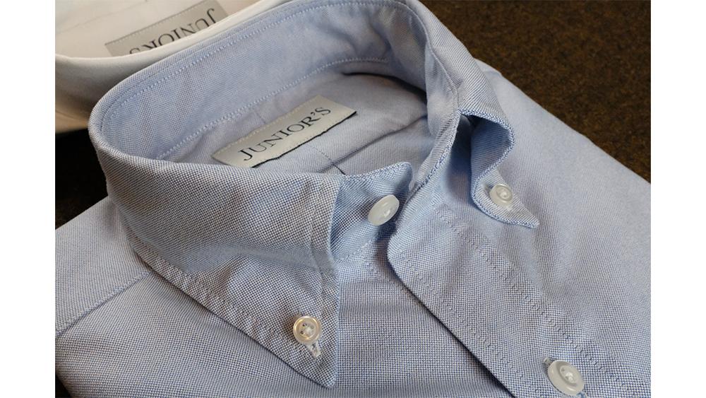 The artfully rolled collar of Junior's OCBD.