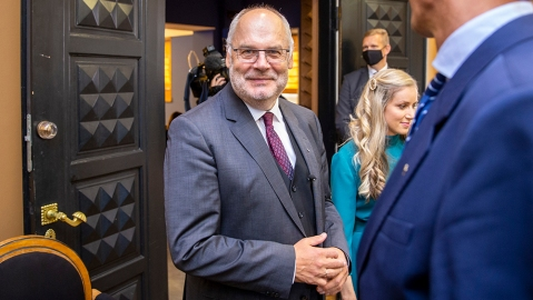 Alar Karis, a former state auditor and university head, smiles as he leaves a hall of Estonia's Parliament in Tallinn, Estonia, Tuesday, Aug. 31, 2021. Estonia's Parliament has elected the chief of a major national museum as the Baltic country's new president in the second round of voting after he was rejected by lawmakers in Monday's first voting round even though he was the only candidate. (AP Photo/Raul Mee)