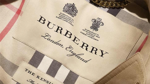 Burberry's label gives pride of place to the brand's two Royal Warrants.