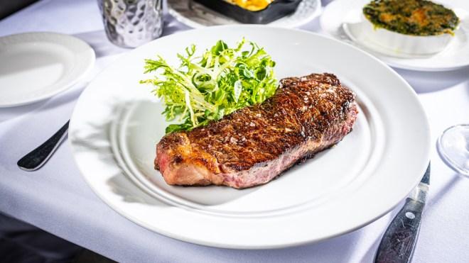new york strip steak white tablecloth