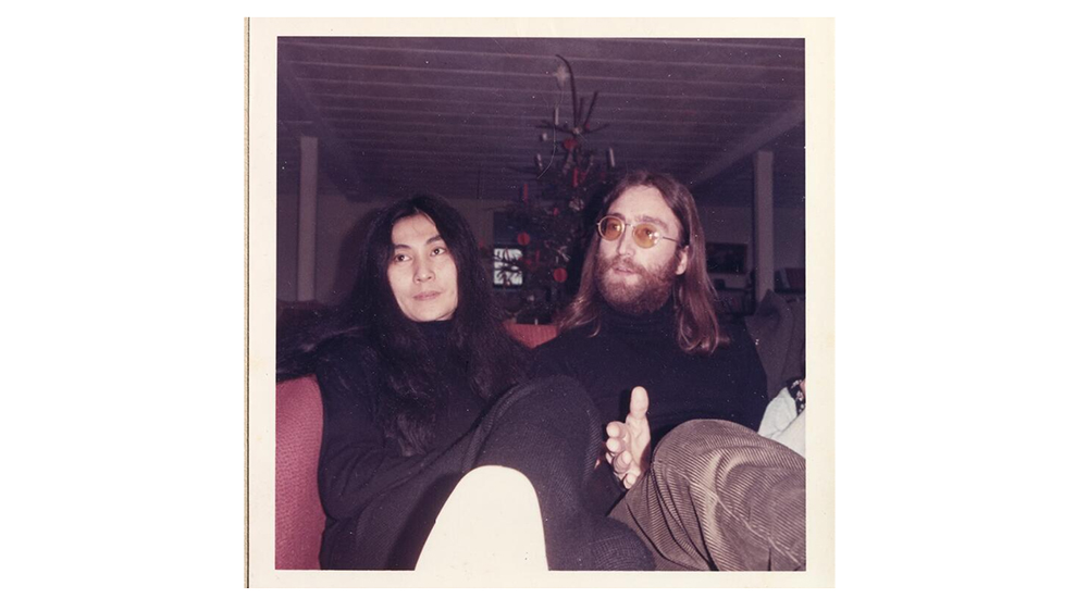 A photo of John Lennon and Yoko Ono at the press conference