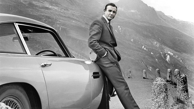 """Actor Sean Connery and his Aston Martin DB5 from the 1964 film """"Goldfinger."""""""
