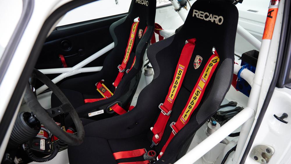 The interior of a 1995 Porsche 911 Cup 3.8 RSR Evo race car.