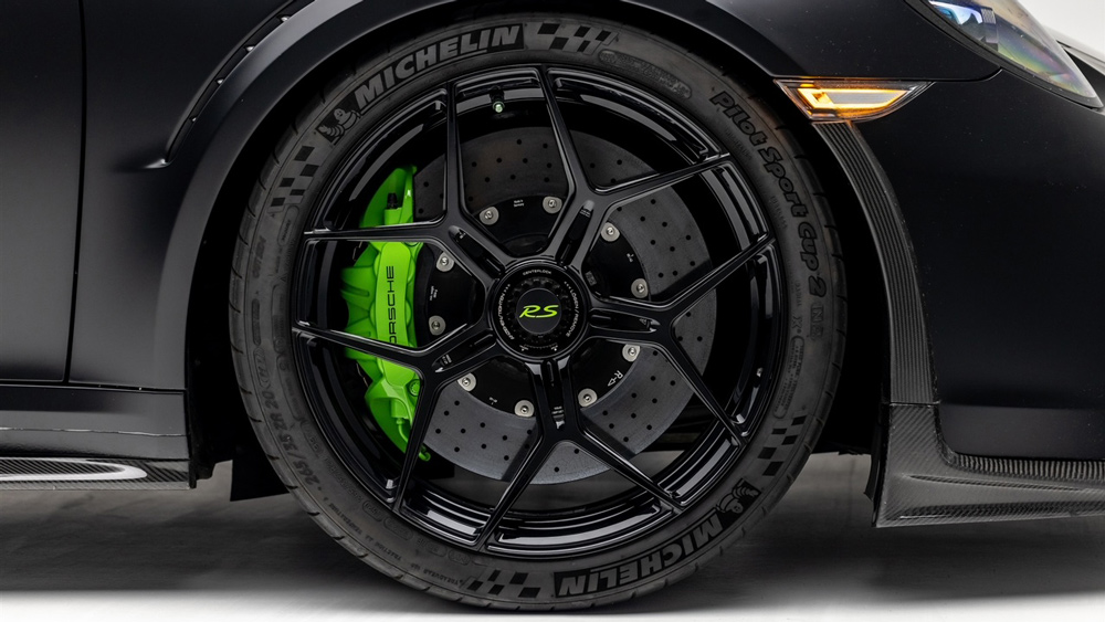 A detail of a wheel from a Porsche 911 GT3 RS that's been customized by Global Motorsports Group.