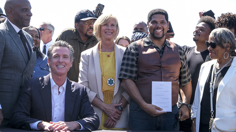 California Governor Gavin Newsom and Anthony Bruce at the bill signing