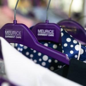 Shirts on Meurice Garment Care's hangers.